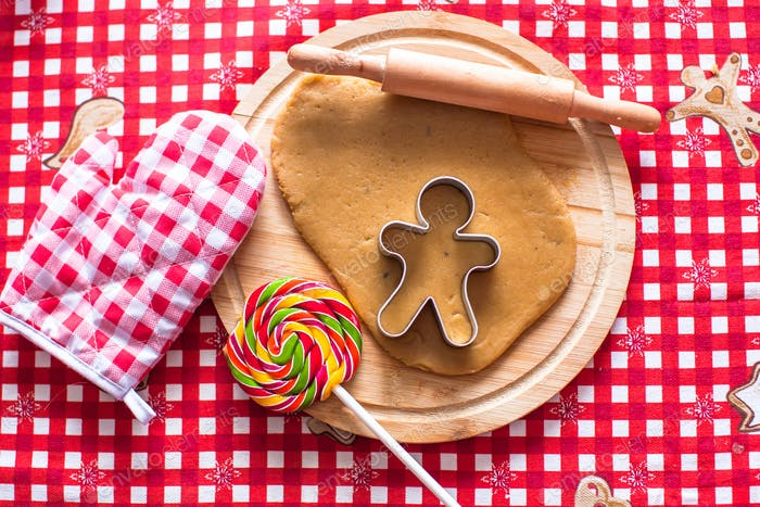 Cutting the gingerbread cookie dough for Christmas
