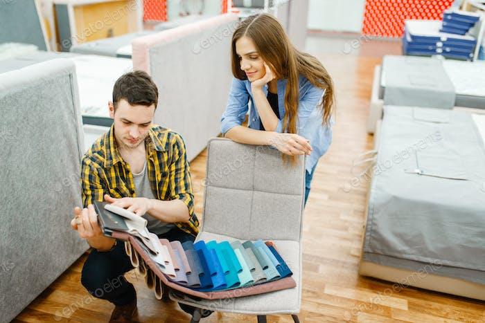 Love couple choosing texture of mattress topper