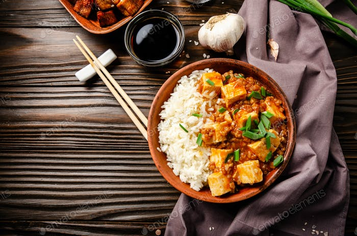 Flat lay view at authentic traditional Chinese food mapo tofu dish with pork