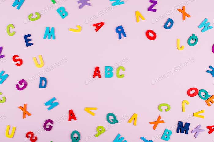 Back to school concept. Bright multicolored alphabet background. Colorful wooden letters