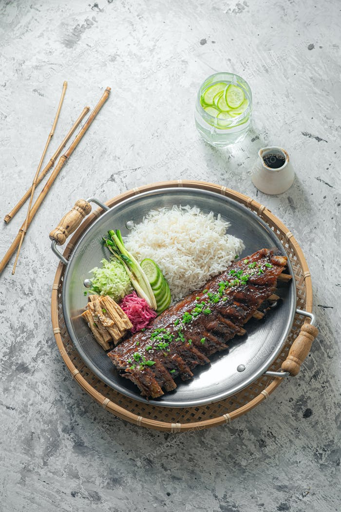 Asian style pork short ribs with rice and vegetables