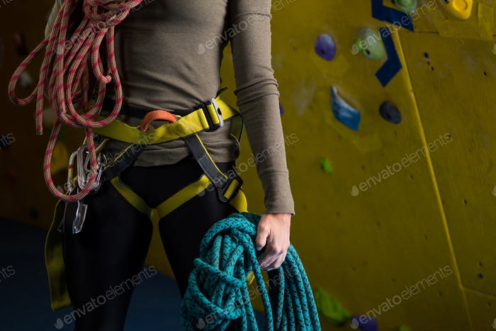 Woman with rope in fitness studio