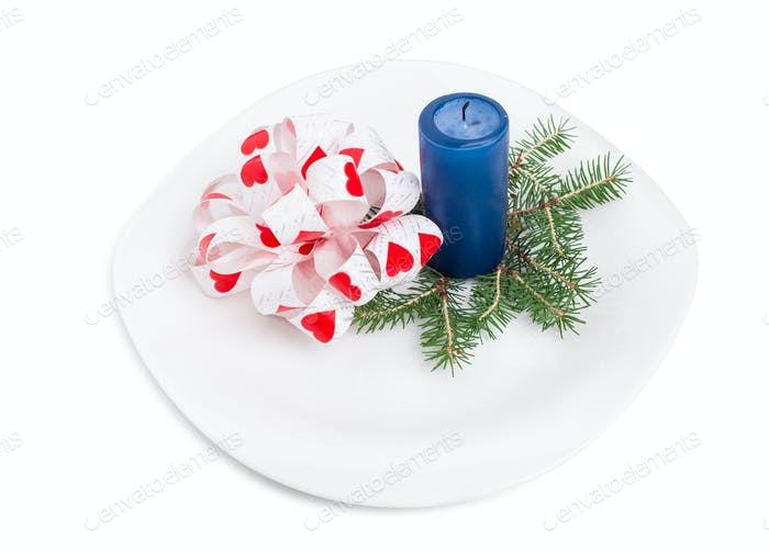 Bow-knot with fir branch and blue candle.