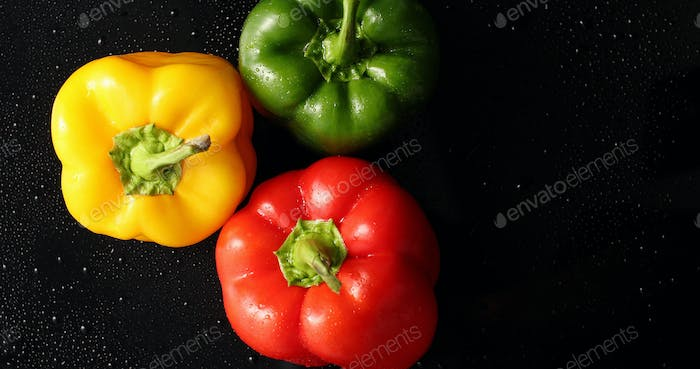 Three colorful fresh peppers