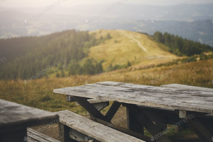 Wooden table against mountains, background
