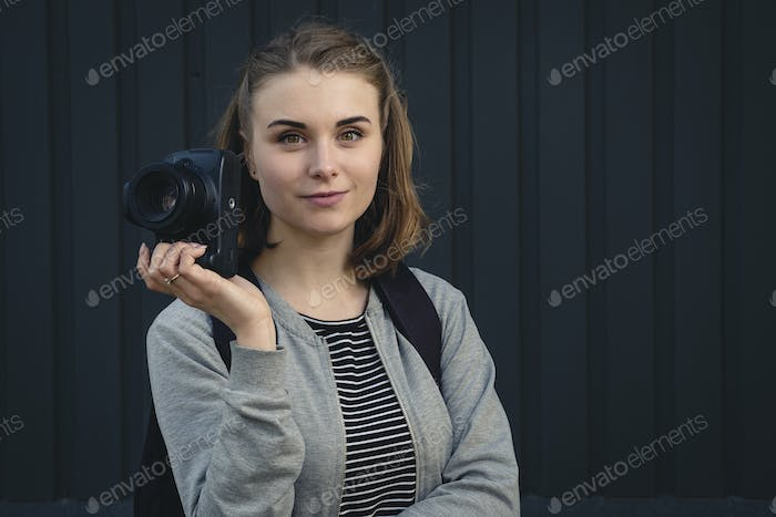Female photographer with a quiet friendly smile