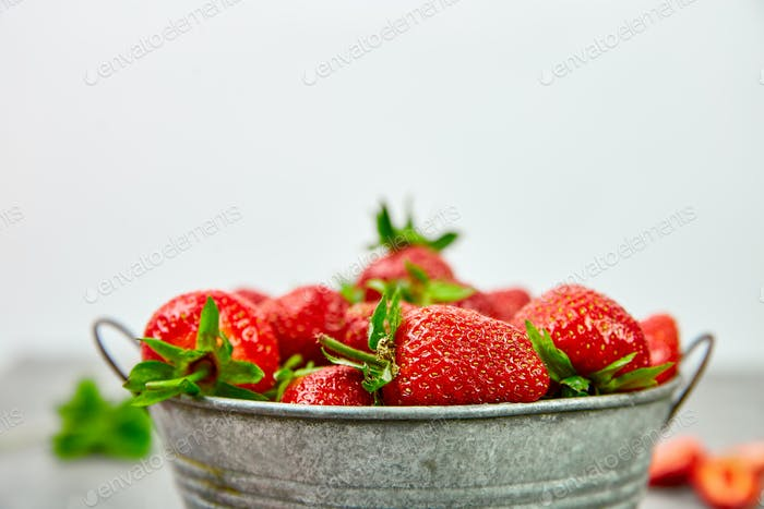 Strawberries in grey bowl. Fresh strawberries. Beautiful strawberries.