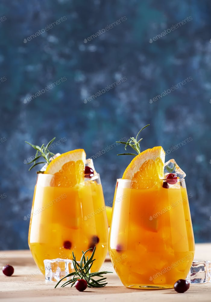 Fresh cocktail with orange, cranberry, rosemary and ice. Alcoholic, non-alcoholic drink