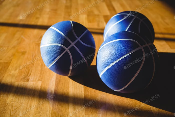 Hgh angle view of blue basketballs in court