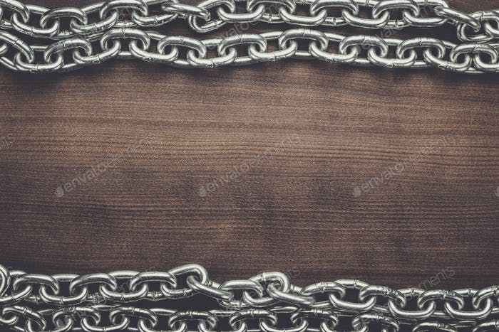 big chains on the wooden background