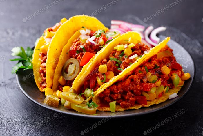 Taco with Beef, Mexican Traditional Cuisine. Dark Background. Close up.