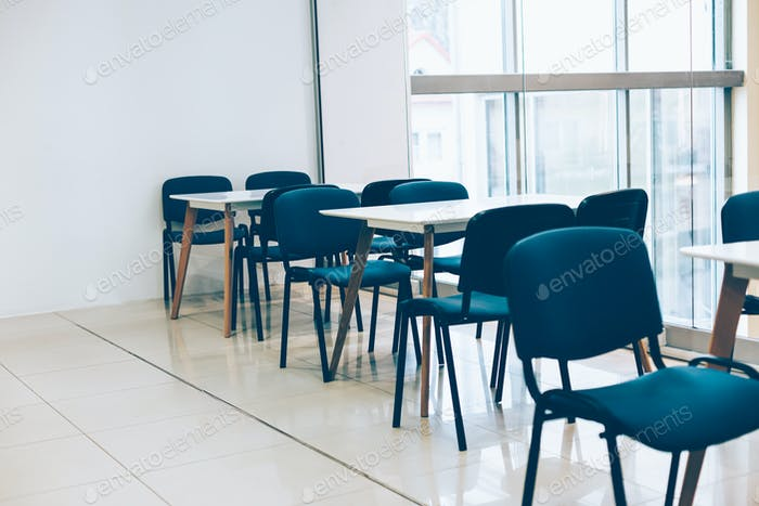 Coworking room space with tables and chairs