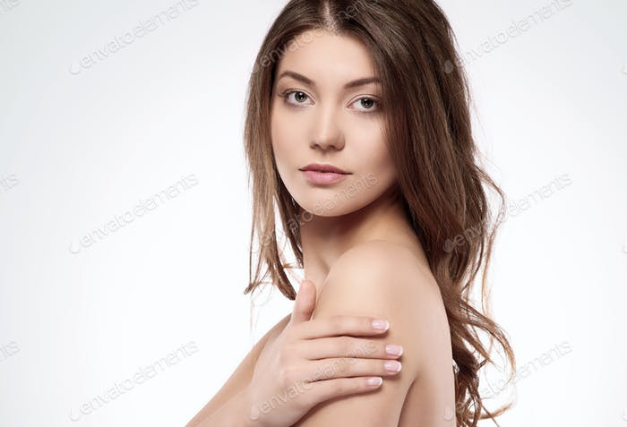 Naked woman on neutral background