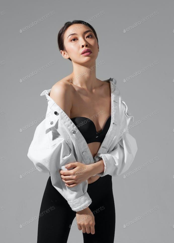young asian female fashion model, studio shot