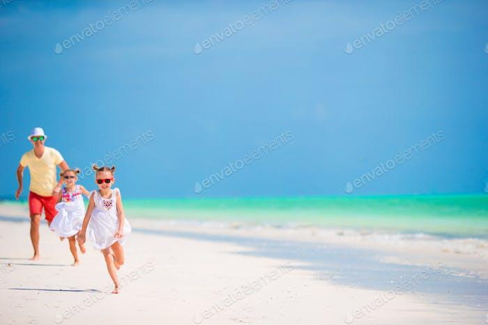 Young family enjoying beach summer vacation