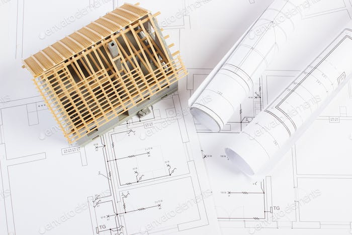 Electrical diagrams with small house under construction, concept of building home