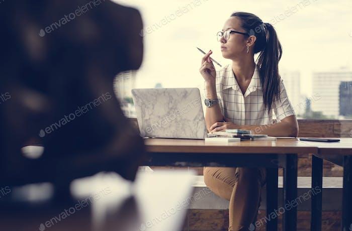 A caucasian woman thinking