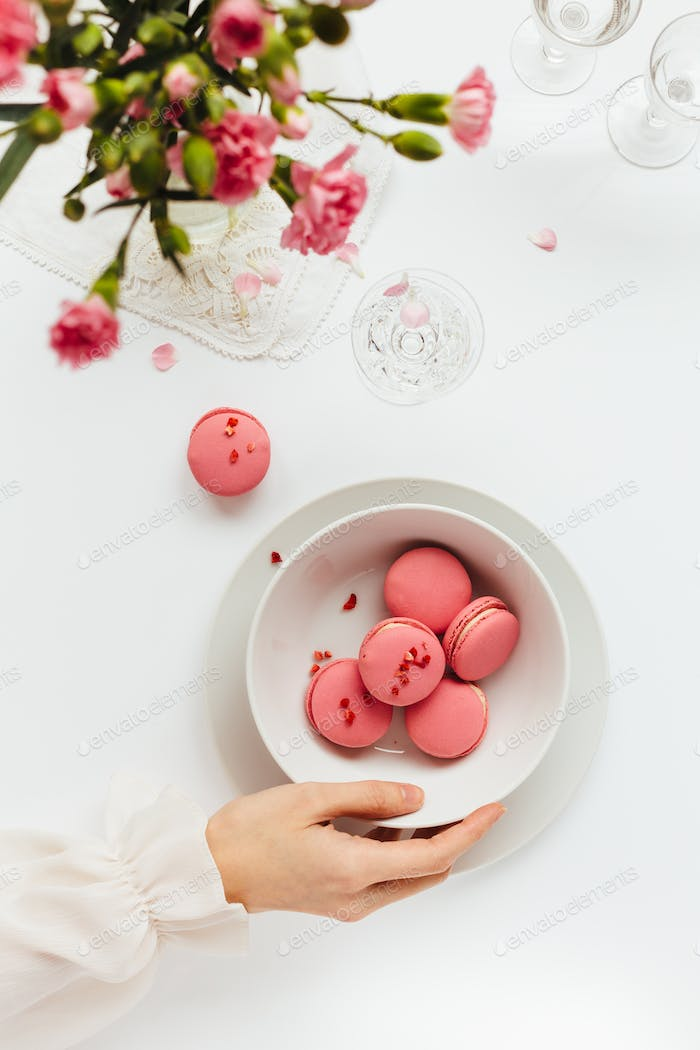 Bowl of Pink Macarons on White Table