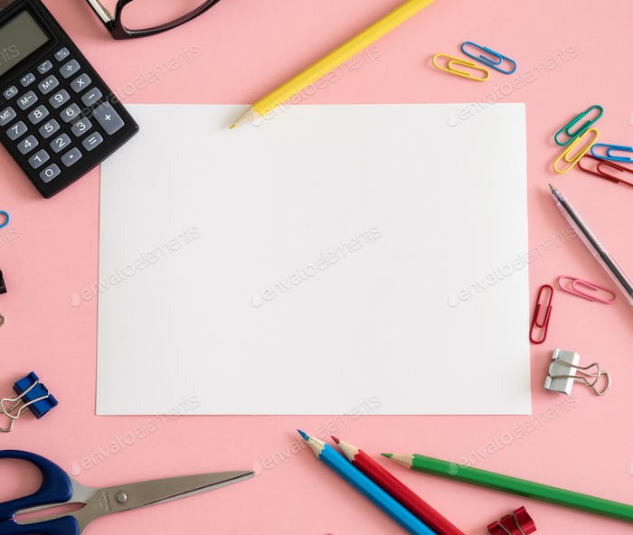 Colorful stationery on pink background