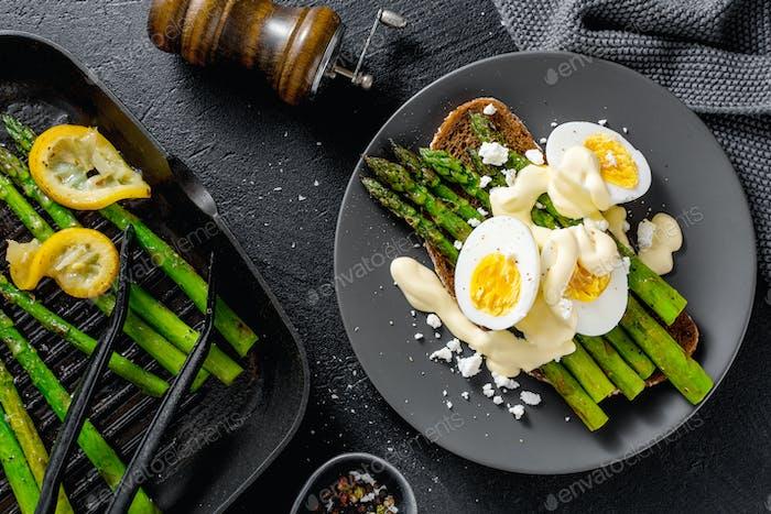 Tasty toasts with asparagus, eggs and sauce