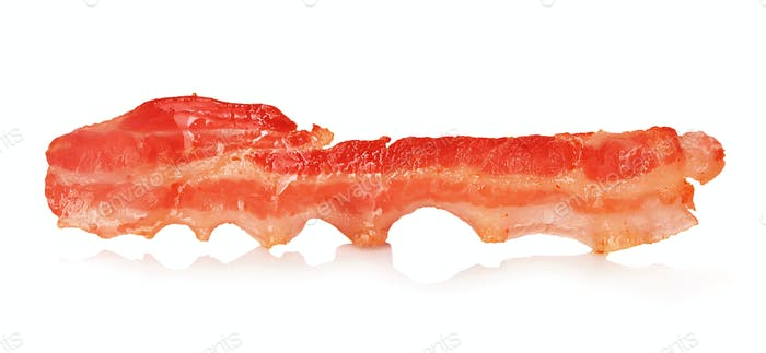 A strip of fried bacon closeup isolated on a white background. Classic american style.