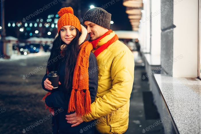 Urban winter evening, portrait of couple outdoors