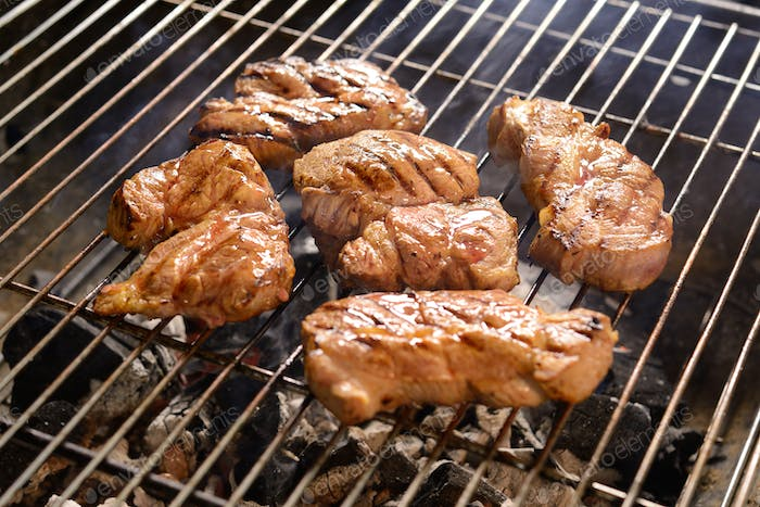 Grilled meat /steak on a grilled with smoke