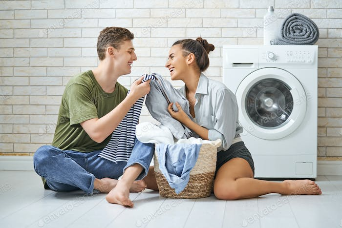 loving couple is doing laundry