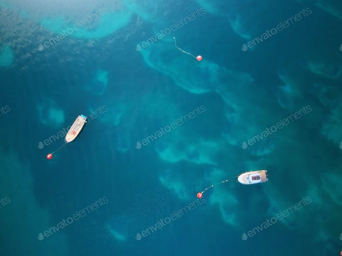 Aerial view of boats in sea.