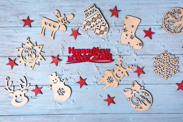 "Christmas wooden with hanging toys and ""Merry Xmas"" greeting text written with small red letters"