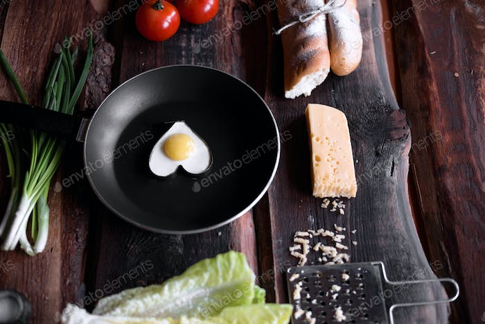 Fried eggs on a wooden background