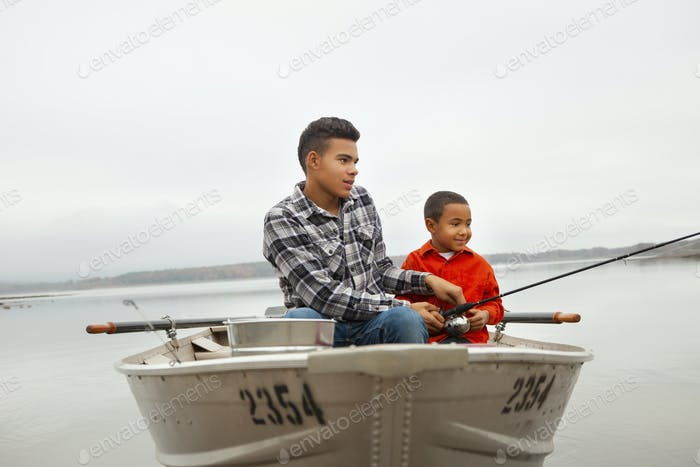 A day out at Ashokan lake. Two boys sitting fishing from a boat.