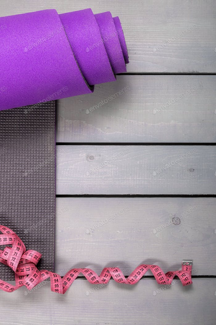 Violet mat and tape on the table.