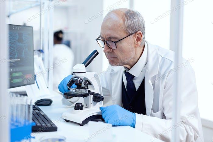 Senior man working in life science laboratory