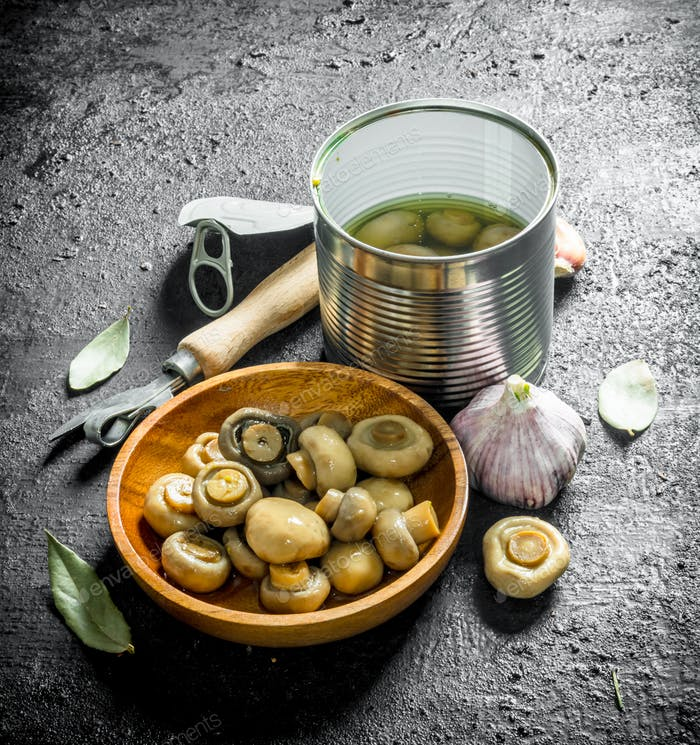Canned mushrooms with garlic and Bay leaf.