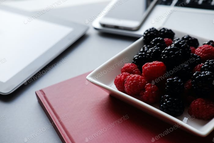Raspberry and blackberries, healthy lunch in the office