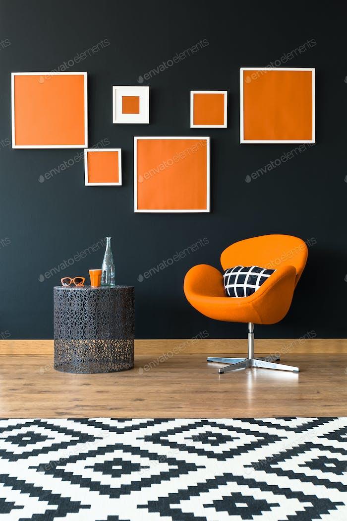 Orange chair next to table