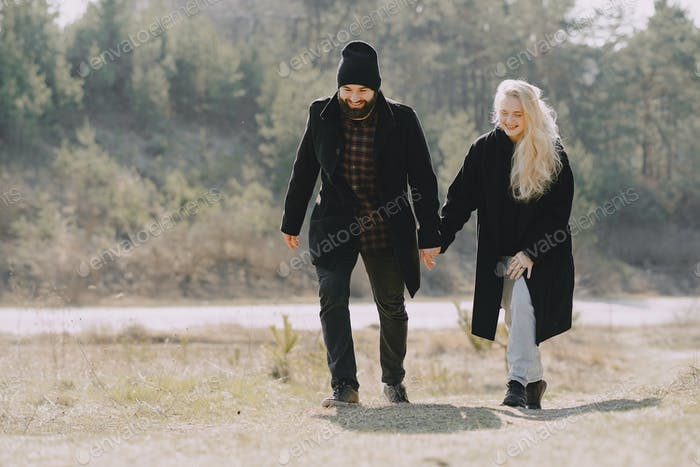 Beautiful couple spend time in a spring forest