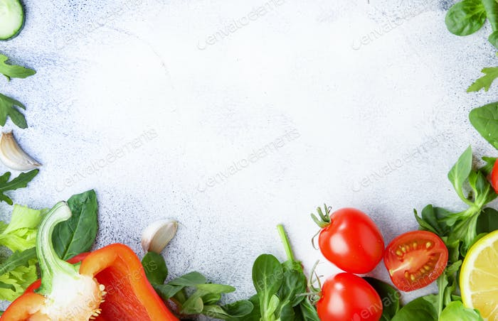 Healthy food background with various green herbs and vegetables