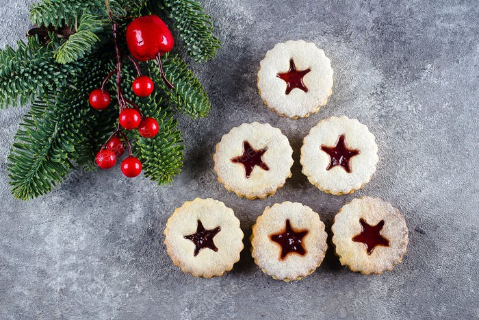 New Year 2021 Tree. Christmas Linzer cookies with jam and fir tree branch