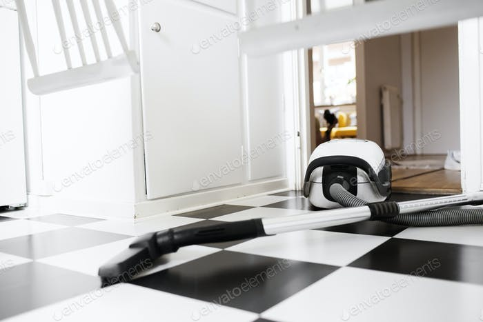 Vacuum cleaner on tiled floor