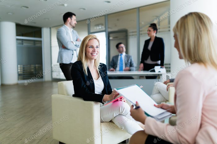 Picture of attractive saleswoman working in office