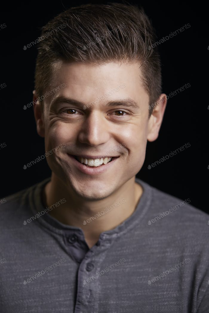 Portrait of a smiling young white man looking to camera, vertical