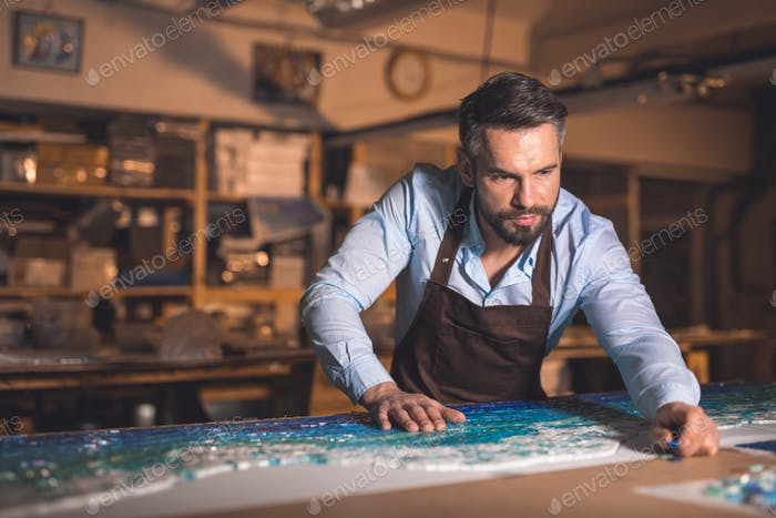 Mature man in an apron