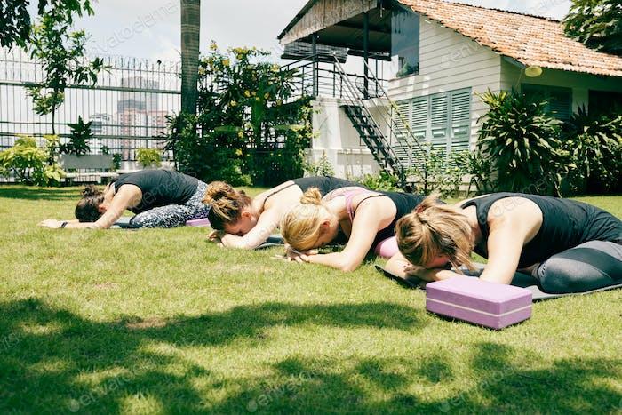 Sportswomen Resting in Childs Pose
