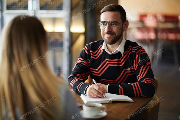 Man talking to colleague
