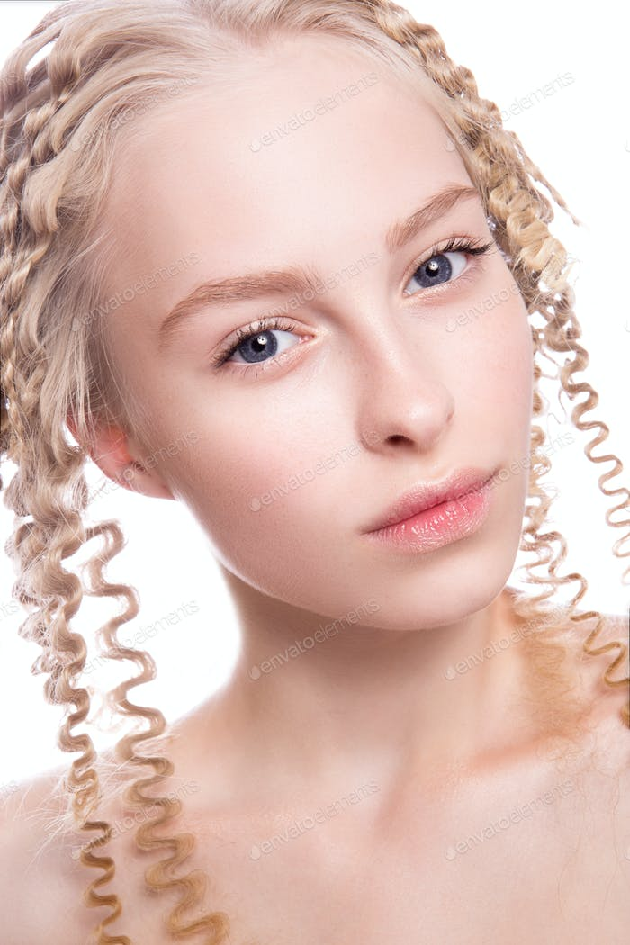 Portrait of a beautiful woman with curly blonde hair