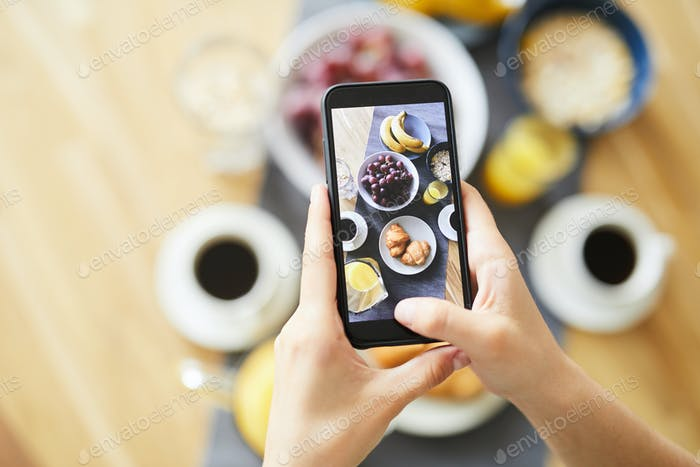 Fresh food and snack served for breakfast on touchscreen of smartphone