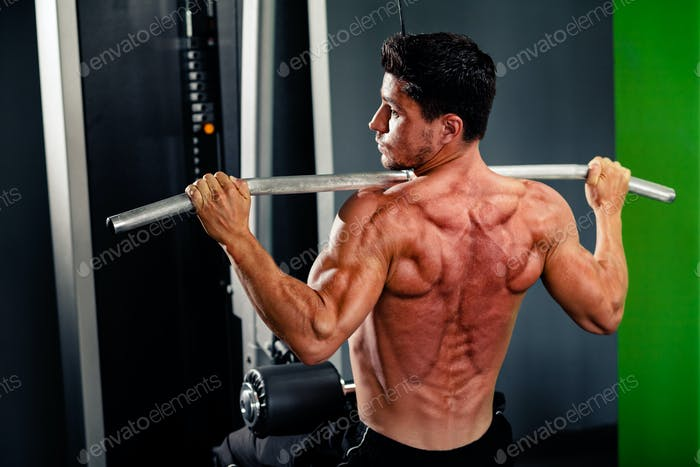 muscular man work out in gym