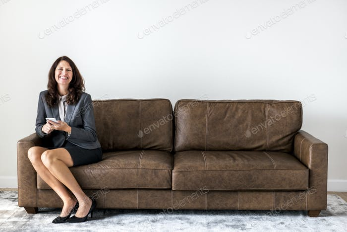 Businesswoman sitting alone on the couch